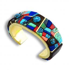 A mosaic inlay gold cuff made by Alvin Yellowhorse Native American Jewelry