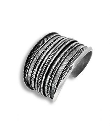 A horizontal pattern cuff made by Harrison Jim Santa Fe Native American Jewelry