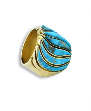 A gold ring with turquoise made by Earl Plummer Santa Fe Native American Jewelry.