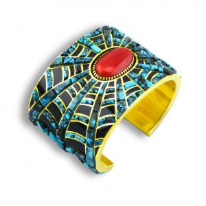 A top shot of a coral and gold cuff by Earl Plummer Santa Fe Native American Jewelry.