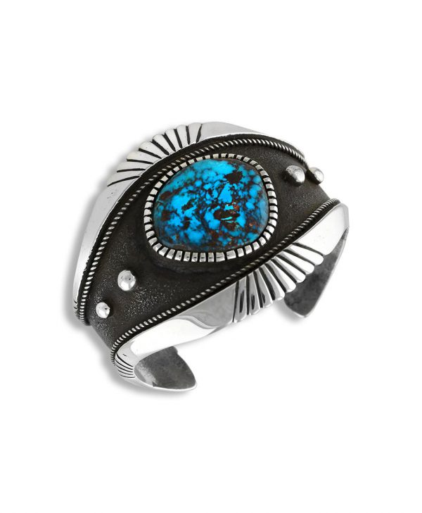 A silver and turquoise cuff made by Edison Cummings Santa Fe Native American Jewelry