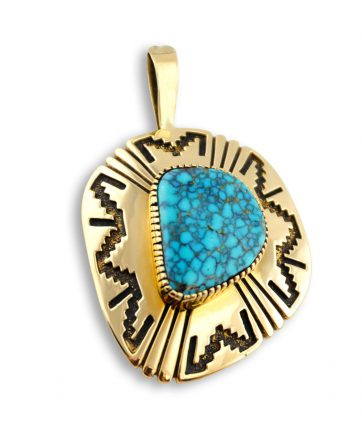 A turquoise pendant made by Tommy Jackson Santa Fe Native American Jewelry.