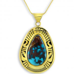 A gold and turquoise pendant Santa Fe Native American Jewelry
