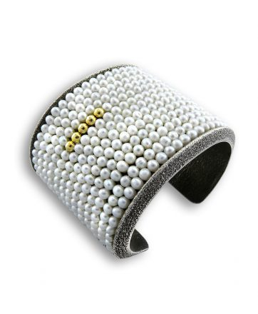 A sterling silver cuff made by Olin Tsingine Santa Fe Native American Jewelry.