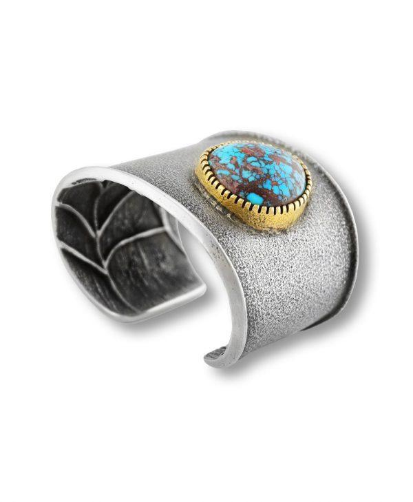 A sterling silver cuff made by Olin Tsingine Santa Fe Native American Jewelry.