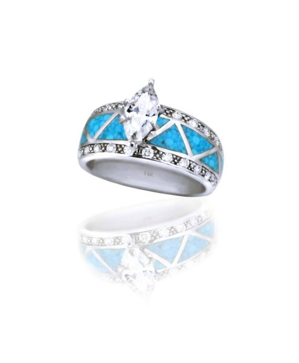 A White gold and Turquoise Inlay ring designed by Kennys on the Plaza.