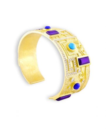 A gold bracelet made by Ric Charlie Santa Fe Native American Jewelry.