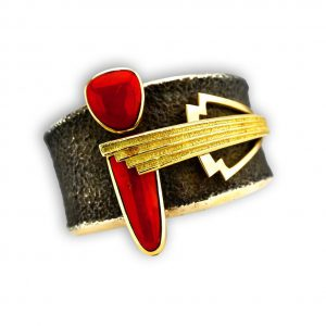 Michael Roanhorse Santa Fe Native makes an amazing Gold and Red Cuff Bracelet.