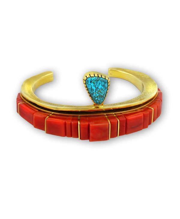 A red coral and turquoise bracelet made by Wes Willie Native American Jewelry.
