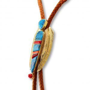 A close up shot of a turquoise bolo tie by Wes Willie Santa Fe Native American Jewelry.